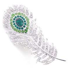 This fashionable crystal peacock feather broach features crystal details mounted on a silvertone base metal with an antiqued finish. This trendy design is sure to add a little glamour to any outfit. This design closes with a classic pin clasp.