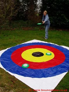 frisbee game: could also paint a bullseye on the lawn and do this. COOOOOOL., have to try this