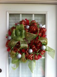 Deco mesh on tree this year. Will make wreath for next year!!
