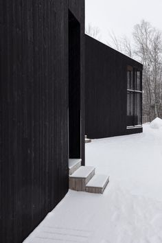 The brothers that commissioned Quebec City-based Atelier Pierre Thibault to create them a shared weekend house each have a separate black block to accommodate their family. Space Architecture, Amazing Architecture, Alpine Modern, Wooden Steps, Garden Floor, Weekend House, Outdoor Living Areas, Wooden House, Cabins In The Woods
