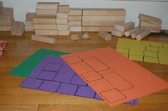 Teach elevation and scale concepts using construction paper and Unit Blocks