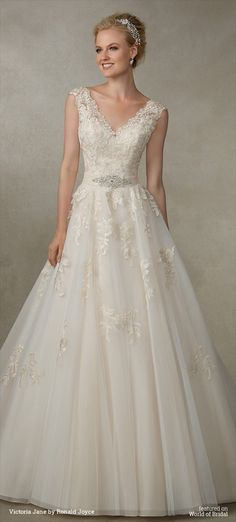 A classic tulle A-line silhouette with beautiful lace appliques, detailed bodice and beaded waistband