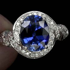 Sapphire Engagement Ring. Would be perfect with a purple stone in the middle :)