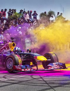David Coultard spins the Infiniti Red Bull Racing show car around the streets in Hyderabad.