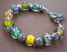 Glass beaded bracelet with sterling silver. Stone Street Studio