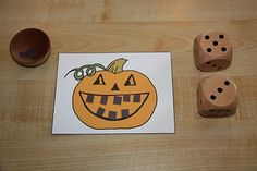 Roll the dice to see how many teeth the jack o lantern gets
