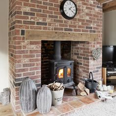 Modern Brick Fireplace Decorations Ideas For Living Room - TRENDEDECOR - Cool Modern Brick Fireplace Decorations Ideas For Living Room. Informations About Modern Bri - Exposed Brick Fireplaces, Brick Fireplace Decor, Exposed Brick Walls, Home Fireplace, Living Room With Fireplace, Fireplace Design, Fireplace Decorations, Fireplace Ideas, Brick Fireplace Log Burner