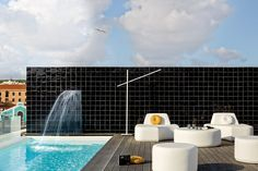 Manutti // Curved outdoor sofa on a rooftop city terrace - Moon Island Collection Outdoor Furniture, Outdoor Decor, Outdoor Sofas, Black Tiles, Rooftop Pool, Foot Rest, Minimalist Design, Wall Tiles, Terrace