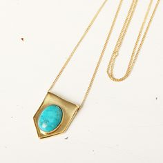 Kisos Gold platted brass necklace, with a turquoise semi precious stone.  Ajustable lenght from 60 to 76 cm. Made in Velvetine's atelier in Paris  Made in France