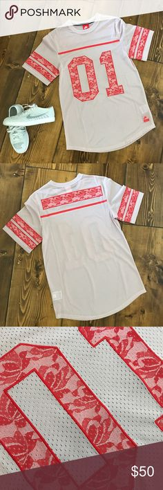 [NIKE] blush pink/red women's lifestyle jersey NWOT women's Nike blush pink & red lace print '01' jersey. This would be adorable with some leggings! Comes from a clean and smoke free home. No trades. Size S. Nike Tops