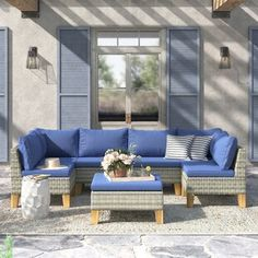 Sol 72 Outdoor™ Merlyn 11 Piece Sectional Seating Group with Cushions | Wayfair Blue Cushions, Seat Cushions, Pool Floats For Adults, Corner Chair, Furniture Covers, Extra Seating, Coastal Homes, Chair And Ottoman, Brown And Grey
