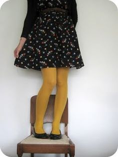 black cardigan, flowery dress, mustard tights, heels or boots