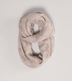 These are SO easy to make with an old sweater just lay it out cut under the armpits and wa la you have a circle scarf.  Which you can wear many ways.
