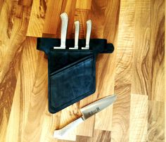 The ZoonderBelt  Smoky Black Chef Knives Belt For chefs who likes their own knives and small tools around them.  3 medium size knives cells (9 longest blade) Other small cells for small tools as spoons and Tweezers A pocket for your cell phone  For a quick kitchen work  - 2 layers of Italian thick leather - Available in 5 colors - 3 medium size professional knives cells (9 longest blade) - Other small cells for other small tools. - A pocket for your cell phone - Bronze belt buckle - made a…
