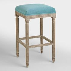 One of my favorite discoveries at WorldMarket.com: Peacock Paige Backless Barstool
