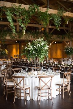 Fresh Greenery Hanging from Venue Ceiling Hanging Beam, Ceiling Hanging, Ceiling Decor, Decoration Table, Reception Decorations, Flower Decorations, Greenery Decor, Ceiling Plan, Ranch Decor