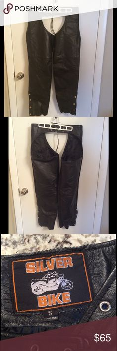 "Men's / Women's Black Leather Motorcycle Chaps These are Unisex black leather motorcycle chaps in Size small. I'm a ladies size 8 now and the legs are just a bit tight for me. Can still zip them but tighter than I would like. These would be better for a size 4-6. I'm 5'5"" and they were cut to my length. From a smoke and pet free home. Silver Bike Pants"