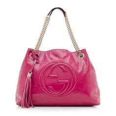 This iconic Gucci tote is made from bright pink patent leather with a central interlocking-G logo and gold-tone hardware. Details include two chain straps, an oversized tassel, snap hook closure, and fully lined interior with two open pockets and one zippered pocket.