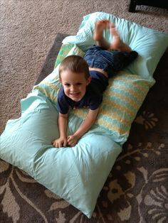 Sew three pillowcases together and stuff them with pillows to create a nap mat. I made it for my home daycare children. Just fold it up when they are done.