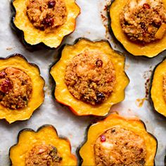quinoa-stuffed acorn squash rings with cranberries, apples, walnuts and sage