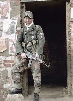 A French Soldier from the Waffen-SS Charlemagne Regiment during the Battle of Berlin, - April 23rd, 1945. i found out it is reenacting http://www.panzergrenadier.net/forum/viewtopic.php?f=25&t=3154&start=30#p125276