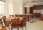 Furnished Apartments in Kampala Family Apartment, 1 Bedroom Apartment, Furnished Apartments, Apartment Complexes, Open Plan, Living Area, Table, Furniture, Home Decor