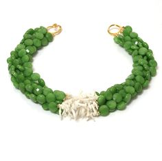 Faceted Green Apple dyed green Jade with White Branch Coral and smooth rondels. 18 inches. A classic Helga Wagner Design incorporating fine White Coral with extreemly green dyed Jade. The shells vary slightly in size, shape and color. Every necklace is unique, color may vary slightly.