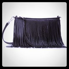 """Rebecca Minkoff Finn Crossbody Fringe Bag Rebecca Minkoff Finn Crossbody Fringe Bag retail $198 NWT  Leather Imported cotton lining Zipper closure 22"""" shoulder drop 6"""" high 9"""" wide Mid-size zip-top handbag with two layers of fringe around full perimeter of bag Removable/adjustable cross-body strap Interior slip pocket Product Information Black Leather Rebecca Minkoff Bags Shoulder Bags"""