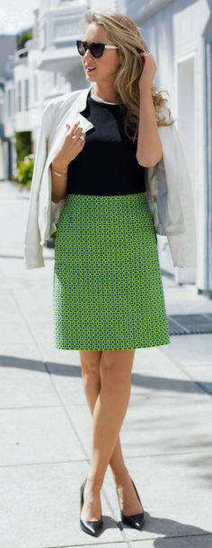 Such a smart look! We love the vibrant green skirt with a subtle pattern paired with a simple top and blazer.