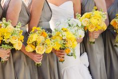 Platinum gray dresses and yellow bouquets.