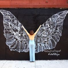 Pen and ink artist, Kelsey Montague, created this amazing and interactive street art, focusing on positivity and the city of New York.