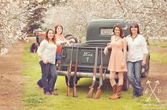Unique Family photo shoot. Tractor, old truck & guns!