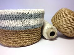 A basket crocheted with garden twine and finished with a contrasting grey and cream cotton trim.   Perfect for storing your odds and ends.   Dimensions 15cm dia, 11cm high