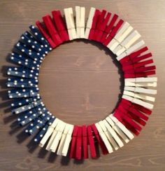 DIY 4th of July Door Hanger Wreath made out of clothespins. Such a cute and patriotic idea for Independence Day!