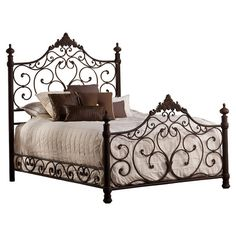 Wrought iron bed with open scrollwork and acanthus leaf accents.  Product: BedConstruction Material: Wrought iro...