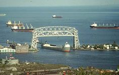 The Aerial Lift Bridge in Duluth, MN can be raised to its full height in about 3 minutes, and goes up 25 to 30 times daily during busy parts of the shipping season. The span is about 390 feet, or 120 meters.