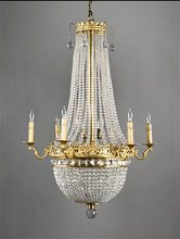 Early 20th Century French Empire Style Beaded 10-Light Chandelier. The ormolu corona is fitted with strands of cascading beads and enhanced with large globular pendants. The pierced ormolu cast frame supports 6 scrolled candle arms fitted for lights and holds a semi-circular basket of graduated beads. The top band of the basket is decorated with large quadrillion shaped crystals. The basket terminates in a faceted crystal pendant. Avail Rubylane.con <3<3<3EXTRAVAGANT - STUNNING<3<3<3 @