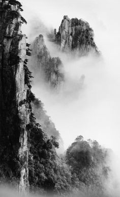 precipice and bookcase peak. taken at peak lying on the clouds. june 2004. by wang wusheng.