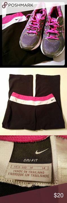 "Size Large Nike Dri Fit Capris Nike Dri Fit Capris  Black and pink Size Medium 8-10 Waist measures flat 14"" Length 30"" Pre-owned Nike Pants Capris"