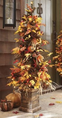 Pre-Lit Autumn Harvest Tree - Artistically created of plastic, fabric and foam, this colorful tree rests in a stately fall planter, ready for display next to a door or on a tabletop.