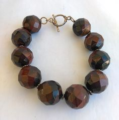 Excited to share the latest addition to my #etsy shop: Vintage Red Tiger Eye Bracelet 16mm Round Faceted Beads Large Beads Statement Bracelet,  Gemstone 925 Sterling Silver Tiger Eye Bracelet http://etsy.me/2F89KS1 #jewelry #bracelet #red #gold #toggle #crystal #women
