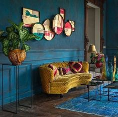 Blue walls with a carved wooden doorframe yellow gold couch
