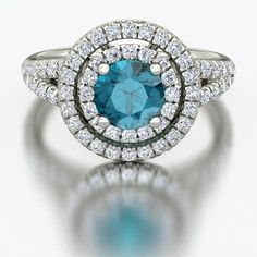 The Eloise Ring in London Blue Topaz and Diamond.  A stunning halo style! #gemvara