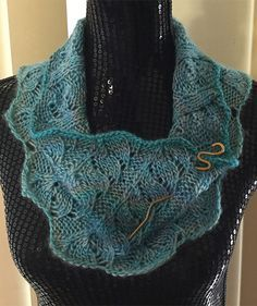 Free Knitting Pattern for Easy 4 Row Repeat Gossypium Cowl - Versatile infinity scarf knit in a 4 row repeat lace pattern. Worsted weight yarn. Designed by Jenn Kinzel Rated very easy by Ravelrers. Pictured project by Donnaputer who knit a longer cowl in DK.