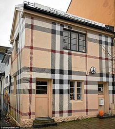 Jens Werner, 33, covered his entire house  in the famous Burberry beige, black and red tartan design. The re-painting of the building in Larvik, Norway, took several weeks at a cost of thousands of pounds.