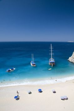 Boats moored in blue waters of Kaputas Keach, near Kalkan. going here for 2 weeks this summer