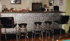 Tin tiled could be very cool to renovate an older temporary mobile bar. Put down some molding but when you are ready to move...pop it out and take it with!