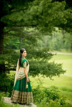 A beautiful emerald green Sabyasachi wedding lehenga seen in a beautiful lush green location at the Copper Greek Golf Club in Toronto. The bride also gets the styling right. Photo courtesy - Kumari Photo Cinema Canada. If you are looking at shopping for your dream Sabyasachi wedding lehenga, write to us at www.bridelan.com and we'll help you with shop for your wedding lehenga and trousseau