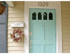 I love this Tiffany blue door and yellow exterior