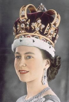 Queen Elizabeth II in her coronation crown, 1953. Known as St Edward's Crown, it was made in 1661 for the coronation of King Charles II, and is reputed to contain gold from the crown of Edward the Confessor. It is set with 444 precious stones.